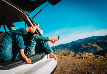 kids relax while travel by car in nature, family vacation in mountains