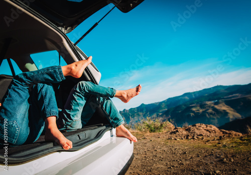 kids relax while travel by car in nature, family vacation in mountains - 251997790