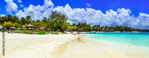 Leinwandbild Motiv Relaxing tropical holidays. white sandy beach Bell Mare in beautiful Mauritius island