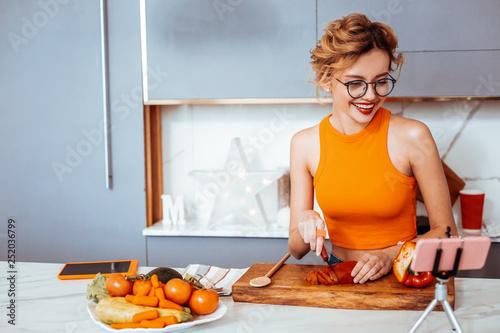 Joyful happy woman having online video stream