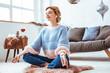 Leinwandbild Motiv Beautiful nice woman practicing yoga at home