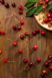Fresh cherry on wooden background