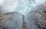 detail of water falling through a pound lock
