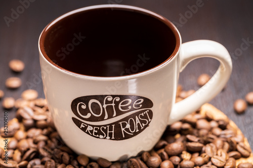 cup of coffee with beans on white background © Roman