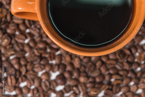 coffee beans and a cup of coffee on a white background © Александр Савич