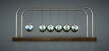 Pendulo de Newton. En las esferas metalicas aparece la palabra Newton.