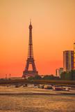 Fototapeta Wieża Eiffla - Sunset view of  Eiffel Tower and river Seine in Paris, France. © Olena Z