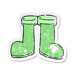 retro distressed sticker of a cartoon wellington boots