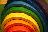 Fototapeta Tęcza - The wooden toy rainbow consists of eight original parts. © imamchits