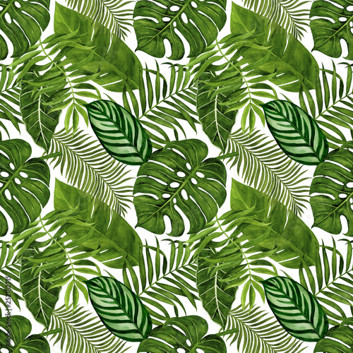 Seamless pattern with tropical leaves for fabric, wallpaper, wrapping paper, etc. Tropical leaves watercolor hand painted. © Nadezhda St.