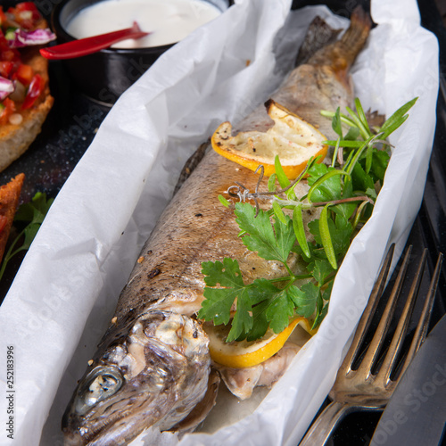 Leinwanddruck Bild the perfectly baked oven trout with lemon and herbs