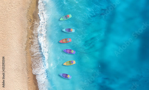 Boats from air. Aerial view on sea in Turkey. Summer seascape with clear water in sunny day. Top view of boats from drone. Summer seascape from air. Travel - image © Biletskiy Evgeniy