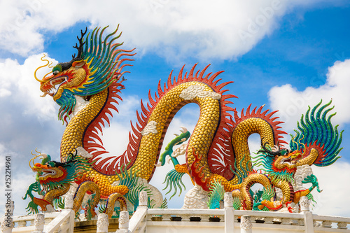 Beautiful giant or big colorful dragon statue with blue sky