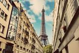 Fototapeta Wieża Eiffla - Eiffel Tower seen from the street of Paris © Photocreo Bednarek