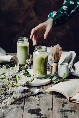 Matcha Latte on a dark wooden background © Irina Kizimenko