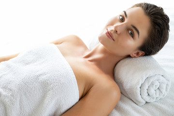 Young and beautiful woman is lying and relaxing after massage session © blackday