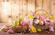 Leinwandbild Motiv Easter holiday basket with beautiful spring flowers and nest with Easter eggs.