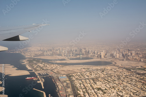 Dubai's buildings and harbor seen from the airplane taking off