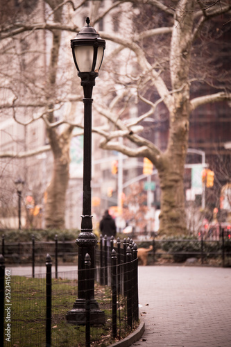 Urban park scene with street lamp from Madison Square Park in Manhattan