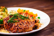 Grilled steak with potatoes and vegetable salad - 252402359