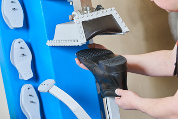 Shoemaker repair shoe. Pressing the sole for male footwear