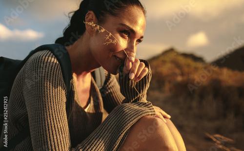 Leinwanddruck Bild Female hiker taking a rest after a country walk