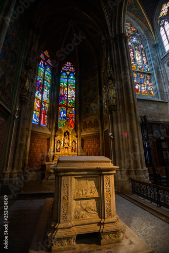 VIENNA, AUSTRIA - AUGUST 11, 2017: Interior of the Votive Church in Vienna. The church was consecrated in 1879 and is in Gothic revival style - 252424569