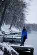 Woman standing on pier at winter forest