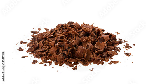 Grated chocolate. Heap of ground chocolate isolated on white background, closeup