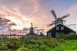 Leinwanddruck Bild - Traditional Dutch windmills at dusk, Zaanse Schans, Amsterdam