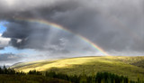 Fototapeta Tęcza - Double rainbow and dark clouds on An Liathanach mountain at Loch a Chroisg near Badavanich Scottish Highlands Scotland UK © Reimar