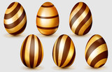 Set of realistic golden Easter eggs with glares, chocolate stripes and soft shadows on white background