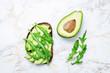 Leinwandbild Motiv Arugula avocado rye breakfast sandwich