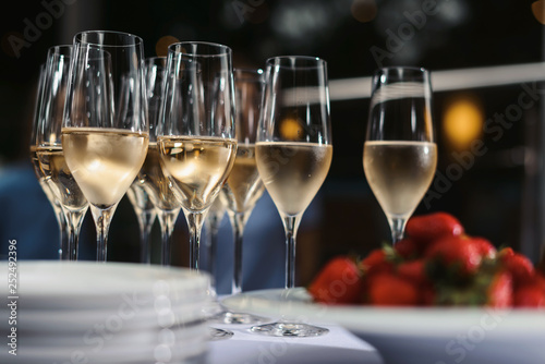 Glasses with champagne or wine at the event. Catering concept - 252492396