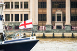 Fototapeta Londyn - Waving Flag of the City of London on a boat on the Thames river in London, UK.  Travel concept and Holiday concept. Moving boat on river. © blazekg