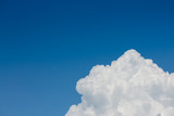 Fototapeta Na sufit - fluffy white cloud above clear blue sky background © sutichak