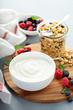 Leinwanddruck Bild - Plain yougurt with granola and berries on side