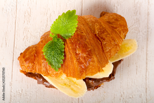 Croissant with chocolate and banana