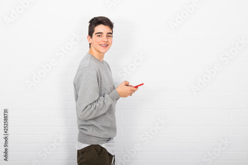 young man on the wall with mobile phone