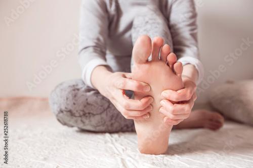 Acupressure on the feet. Foot health. Woman having massage on her feet.