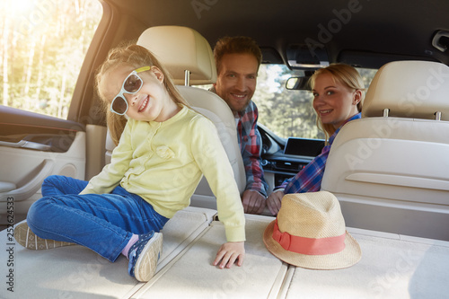 Cute small girl playing inside car. Family road trip - 252624533