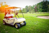 Golfcar in beautiful golf course in the evening golf course with sunshine