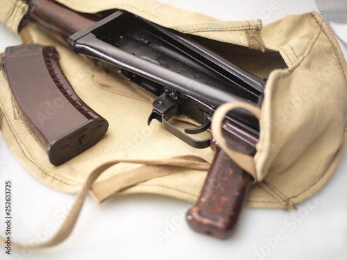 Machine gun and magazine in cloth bag © vectorass
