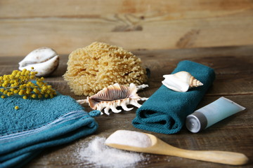 terry massage and spa mittens, salt in a wooden spoon, towel, shells and flowers for decoration with copy space for text © Ирина Грин