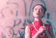 a portrait of Chinese woman wearing Chinese traditional Cheongsam praying