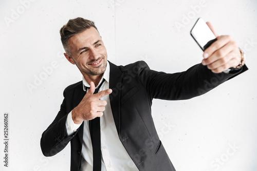 Leinwanddruck Bild Handsome confident businessman