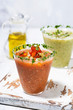 fresh cold soups. red and green gazpacho in glasses, vertical