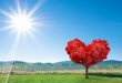 fantasy valentines landscape with red tree in shape of heart