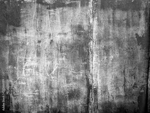 black grunge texture wall background with grain and dust © andreusK