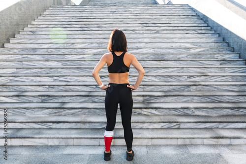 Confident young sports woman resting after exercising